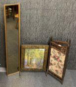 A hammered brass fire screen, a wooden fire screen (H. 81cm) and a gilt framed mirror.