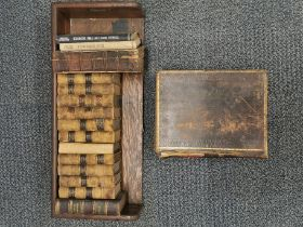 An oak library carrying book rack together with various leather bound books including history of