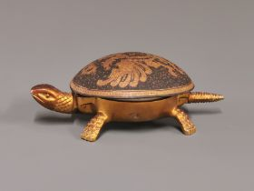 An interesting Spanish gilt metal tortoise bell (operated by depressing the tail), L. 15cm.