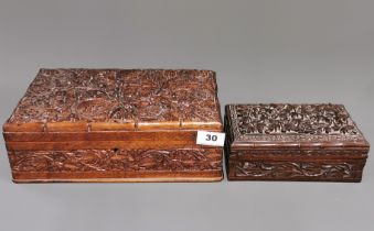 Two carved wooden work boxes, largest 30 x 20 x 10cm.