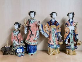 A group of four handmade Chinese porcelain figures of ladies, tallest 29cm.