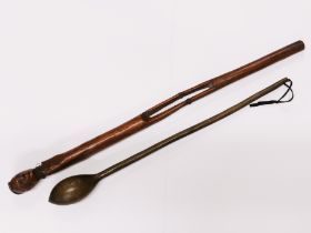 An African carved wooden tribal stick with brass wire binding, L. 68cm. together with a knobkerrie.