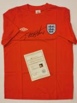 A 1966 England replica jersey t-shirt signed by Sir Geoff Hurst (British, b. 1941) with