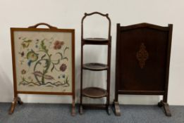 An Edwardian mahogany cake stand and two fire screens.