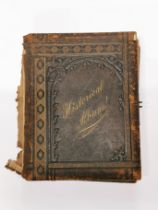 A Victorian leather photograph album with decorated pages 'Memorial of England's Glories', 23 x