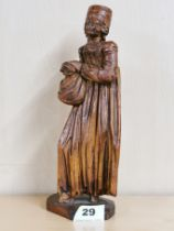 A lovely 17th C carved limewood figure of a lady with glass eyes. Notation to the base refers to