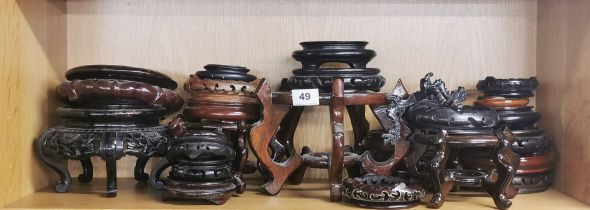 A large group of Chinese wooden stands.