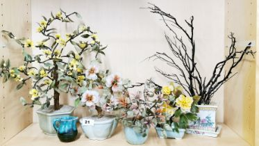 A group of four Chinese glass bonsai trees in porcelain bowls together with a further porcelain bowl