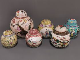 A group of six Chinese hand painted porcelain jars and lids, largest 22cm.