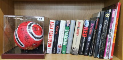 A 1990's signed Manchester United football together with a collection of team related books.