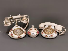 Two vintage Royal Albert 'Old Country Roses' telephones and sugar bowl.