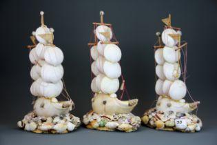 Three interesting shell galleons, H. 39cm.