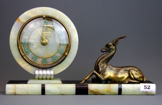 An Art Deco onyx and gilt metal mantle clock, W. 38, H. 22cm. Understood to be in working order.