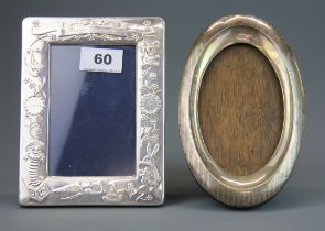 A hallmarked silver child's photo frame, 13 x 17cm (engraved) together with a further hallmarked