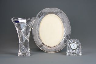 A Marquis Waterford crystal vase, photo frame and clock, tallest 22cm.