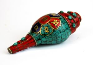 A Tibetan mosaic decorated conch shell trumpet. Conch shell L. 15cm.