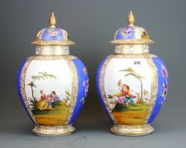 A pair of 19th / early 20th Century German porcelain jars and lids, H. 32cm. Some A/F.