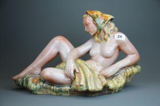 A mid 20th Century Czechoslovakian Goldscheider type glazed pottery figure of a female nude, L.