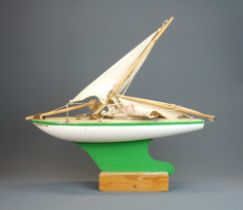 A vintage mounted model of a wooden pond yacht, L. 45cm.
