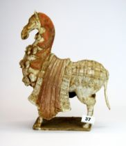 A lovely Chinese Wei dynasty (386 - 534 AD) style unglazed pottery figure of a ceremonial horse (