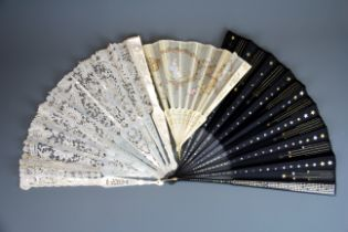 A Victorian carved mother of pearl and lace fan (A/F), L. 30cm, together with two further 19th