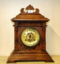 A carved oak American Ansonia 8 days Sharon striking mantle clock , H. 43cm.