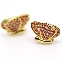 A pair of 925 silver gilt stud earrings set with rubies, L. 1.2cm