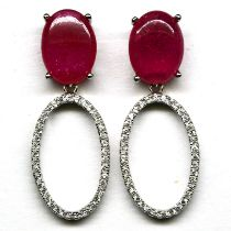 A pair of 925 silver drop earrings set with large cabochon cut rubies and white stones, L. 3.7cm.