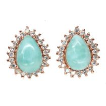 A pair of 925 silver rose gold gilt stud earrings set with pear cut larimar surrounded by white