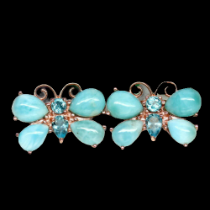 A pair of 925 silver rose gold gilt butterfly shaped earrings set with cabochon cut larimar and blue