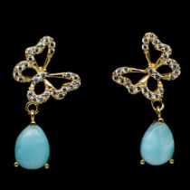 A pair of 925 silver gilt drop earrings set with pear cabochon cut larimar and white stones, L. 2.