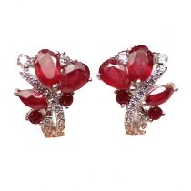 A pair of 925 silver earrings set with pear cut rubies and white stones, L. 1.5cm.