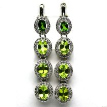 A pair of 925 silveer drop earrings set with peridots surrounded by white stones, L. 4.5cm.