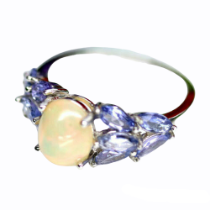 A 925 silver ring set with a cabochon cut opal and tanzanites, (N).