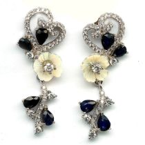 A pair of 925 silver drop earrings set with carved mother of pearl, sapphires and white stones, L.
