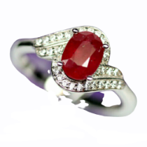 A 925 silver ruby and white stone set crossover ring, (R).