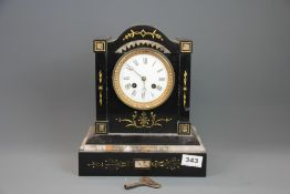 A 19th century French slate and marble mantle clock, H. 29cm.
