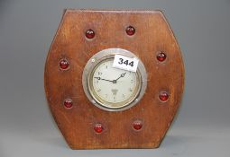 A 'jewel' inset re-used propeller centre mantle clock with Smiths movement, H. 23cm.
