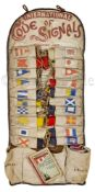 AN ATTRACTIVE ROLLED SET OF 'WOLFF'S PATENT' YACHTING SIGNAL FLAGS, CIRCA 1902