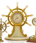 A FINE AND LARGE GILT, BRASS AND AGATE SHIP'S WHEEL DESK BAROMETER, ATTRIBUTED TO BETJEMANN & SONS