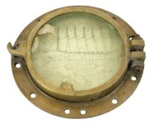 A BRASS PORTHOLE RECOVERED FROM THE WRECK OF THE S.V. THOMAS W. LAWSON SUNK OFF JACKY'S ROCK,