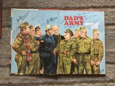 Dads Army multiple signed 1976 annual. Inside page has 11 autographs inc Arthur Lowe, Clive Dunn.