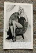 Diana Dors signed 6 x 4 inch sexy b/w photo, slight crease bottom LH. Condition 7/10.