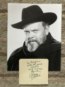 Orson Wells signed note on autograph album page with 10 x 8 inch b/w unsigned photo. Condition 9/10.
