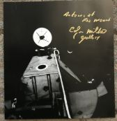 Apollo 14 Moonwalker Dr Edgar Mitchell signed 12 x 12 inch colour page from space book, with rare
