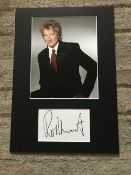 Rod Stewart autograph mounted with 10 x 8 inch colour photo to an overall size 16 x 12 inches.