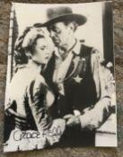 Grace Kelly signed 7 x 5 inch b/w Western movie irregular cut movie magazine photo. Condition 8/