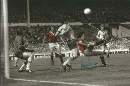 Lou Macari and Jimmy Greenhoff signed 12 x 8 inch colourized Man Utd Football action photo. Good