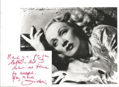 Marlene Dietrich signed white card with 10x8 black and white unsigned photo. Good condition. All