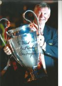 Alex Ferguson signed 12 x 8 inch colour photo to Brad with European Trophy. Good condition. All